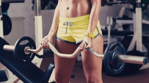 Girl-with-a-sexy-body-lifting-weights-at-gym