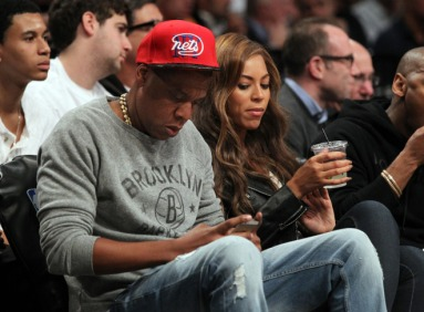 Jay-Z and Beyonce sitting in the front row at the Toronto Raptors vs. Brooklyn Nets at the Barclays Center